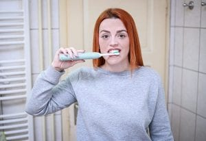 Brush with an electric toothbrush